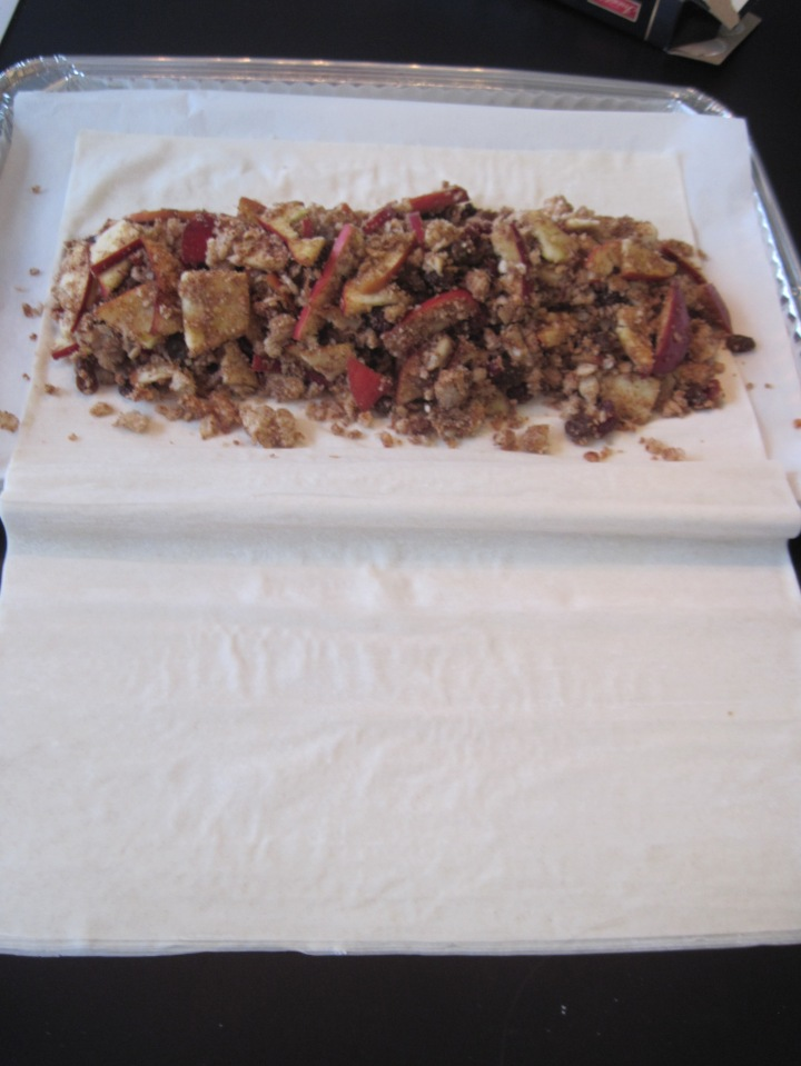 Place mixture in the middle of phyllo dough - leave enough room to wrap it in several layers of phyllo (about 10-15)
